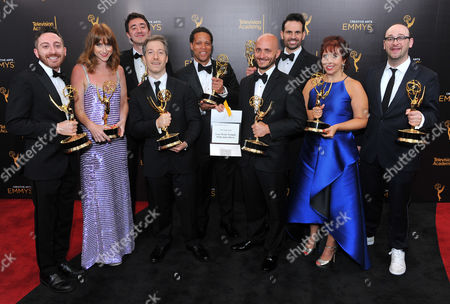 Stock Photo of Dan Gurwitch, from left, Juli Weiner, Will Tracy, Scott Sherman, Kevin Avery, Jeff Maurer, Geoff Haggerty, Jill Twiss, and Josh Gondelman pose for a portrait during night two of the Television Academy's 2016 Creative Arts Emmy Awards at the Microsoft Theater on in Los Angeles