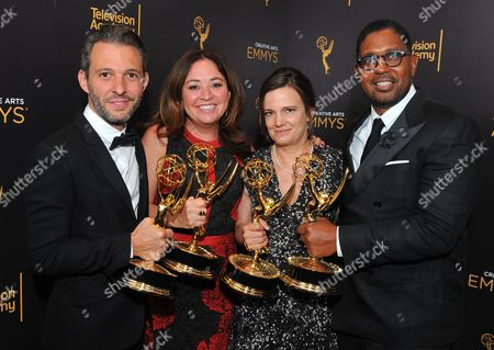 Stock Image of Justin Wilkes, from left, Liz Garbus, Amy Hobby, and Jayson Jackson pose for a portrait with their award for outstanding documentary or nonfiction special during during night two of the Television Academy's 2016 Creative Arts Emmy Awards at the Microsoft Theater on in Los Angeles