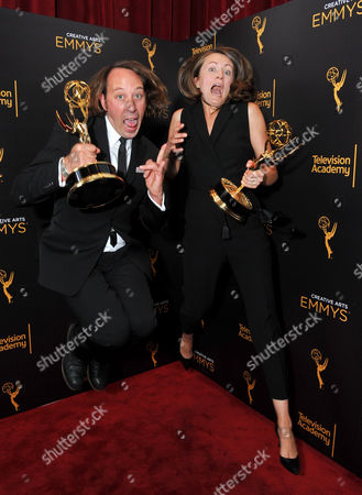 Schuyler Telleen, left, and Katherine Isom pose for a portrait with the award for outstanding production design for a variety, nonfiction, reality or reality-competition series for Portlandia during night two of the Television Academy's 2016 Creative Arts Emmy Awards at the Microsoft Theater on in Los Angeles