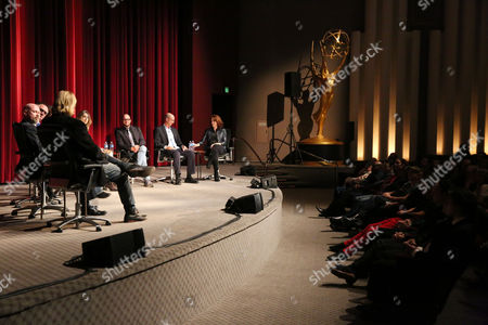 "From left, Matthew Carnahan, Steven S. DeKnight, Hart Hanson, Ali LeRoi, Tara Bennett, Damon Lindelof, Mike Royce, and Janet Tamaro are seen during the panel discussion after the Television Academy's premiere screening of the documentary ""Showrunners: The Art Of Running A Show"" at the Leonard H. Goldenson Theater on in the NoHo Arts District in Los Angeles"