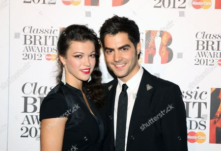 Milos Karadaglic, right, arrives at the Royal Albert Hall for the Classical BRIT Awards on in London, UK