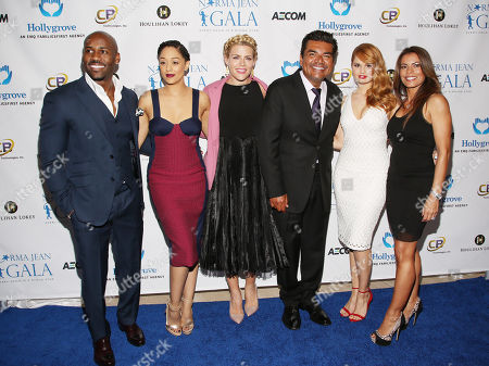From left, Dolvett Quince, Tia Mowry, Busy Philipps, George Lopez, Debby Ryan, and Lisa Vidal attend The Norma Jean Gala 2014 at The Paley Center for Media on in Beverly Hills, Calif