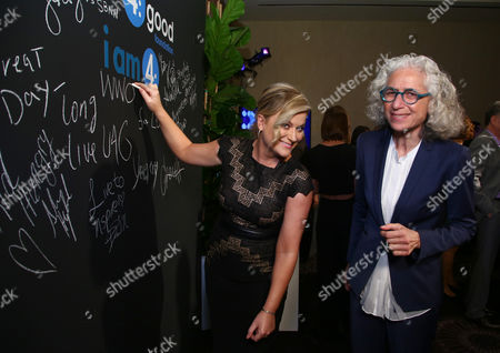 EXCLUSIVE -Amy Poehler, left, and Dr. Jane Aronson sign the chalk wall during unite4:good and Variety's 2nd annual unite4:humanity at the Beverly Hilton Hotel on Thursday, Feb.19, 2015, in Beverly Hills, Calif