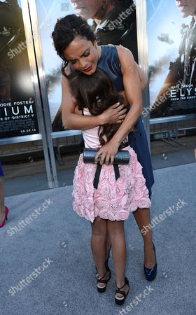 """Actors Emma Tremblay, left, and Alice Braga arrive at the world premiere of """"Elysium"""" at the Regency Village Theater on in Los Angeles"""