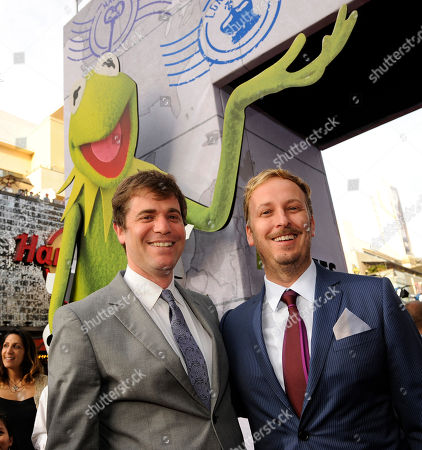 """Stock Photo of James Bobin, right, director/co-writer of """"Muppets Most Wanted,"""" poses with executive producer/co-writer Nick Stoller at the premiere of the film, in Los Angeles"""