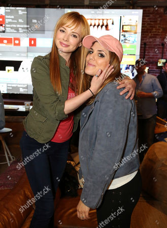 "Ashley Rickards, left, and Molly Tarlov attend the ""Awkward"" live tweet event at The Microsoft Lounge, in Venice, Calif"