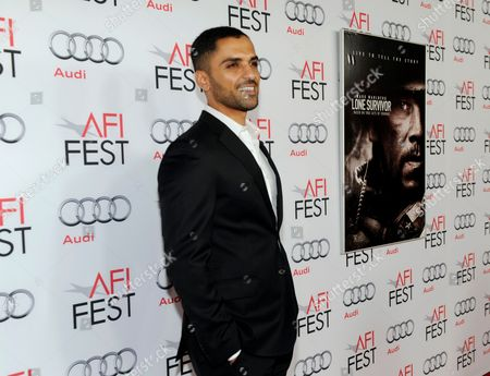 """Sammy Sheik arrives at the AFI FEST premiere of """"Lone Survivor"""" at the TCL Chinese Theatre, in Los Angeles"""