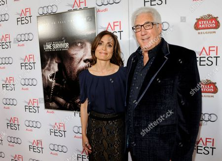"""Sarah Aubrey, left, and Norton Herrick arrive at the AFI FEST premiere of """"Lone Survivor"""" at the TCL Chinese Theatre, in Los Angeles"""