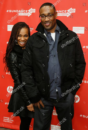 """Director George Tillman Jr., right, and his wife Marcia Tillman pose at the premiere of """"The Inevitable Defeat of Mister and Pete"""" during the 2013 Sundance Film Festival, in Park City, Utah"""