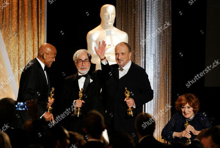 Left to right, actor/singer/activist Harry Belafonte, Japanese animator Hayao Miyazaki, French screenwriter Jean-Claude Carriere and actress Maureen O'Hara pose together onstage with their Honorary Oscars during the 2014 Governors Awards, in Los Angeles