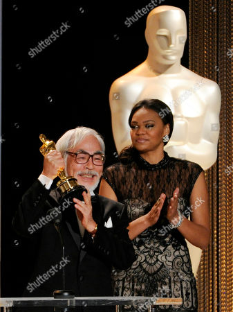 Japanese animator/director Hayao Miyazaki holds up his Honorary Oscar in front of the audience during the 2014 Governors Awards, in Los Angeles