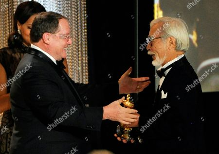 Japanese animator/director Hayao Miyazaki, right, receives his Honorary Oscar from John Lasseter, chief creative officer at Pixar, Walt Disney Animation Studios and DisneyToon Studios, during the 2014 Governors Awards, in Los Angeles
