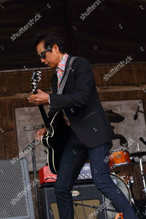 Alejandro Escovedo & the Sensitive Boys performs at the 2014 New Orleans Jazz & Heritage Festival at Fair Grounds Race Course, in New Orleans
