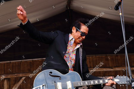 Alejandro Escovedo & the Sensitive Boys perform at the 2014 New Orleans Jazz & Heritage Festival at Fair Grounds Race Course, in New Orleans