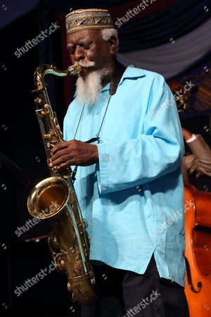 Pharoah Sanders performs at the 2014 New Orleans Jazz & Heritage Festival at Fair Grounds Race Course, in New Orleans