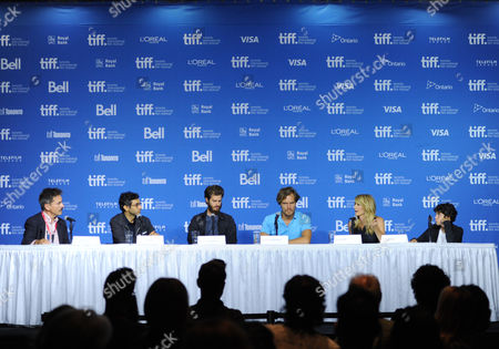 """Moderator Eric Kohanik, and from left, Ramin Bahrani, Andrew Garfield, Michael Shannon, Laura Dern and Noah Lomax attends the press conference for """"99 Homes"""" on day 6 of the Toronto International Film Festival at the TIFF Bell Lightbox, in Toronto"""