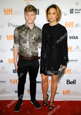 """Antoine-Olivier Pilon, left, and Nancy Grant attend the premiere of """"Mommy"""" on day 6 of the Toronto International Film Festival at the Princess of Wales Theatre, in Toronto"""