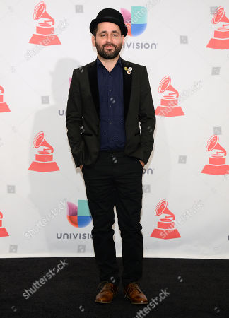 Visitante, of Calle 13, poses in the press room at the 16th annual Latin Grammy Awards at the MGM Grand Garden Arena, in Las Vegas