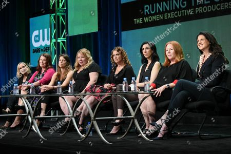 Executive Producers, Wendy Mericle, from left, Diane Ruggiero Wright, Caroline Dries, Julie Plec, Jennie Snyder Urman, Aline Brosh McKenna, Laurie McCarthy and Gabrielle Stanton participate in the 'Running the Show: The Women Executive Producers of The CW' panel at The CW Television Critics Association Summer Tour at the Beverly Hilton Hotel, in Beverly Hills, Calif