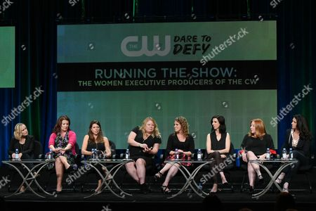 Executive producers Wendy Mericle, from left, Diane Ruggiero Wright, Caroline Dries, Julie Plec, Jennie Snyder Urman, Aline Brosh McKenna, Laurie McCarthy and Gabrielle Stanton participate in the 'Running the Show:The Women Executive Producers of The CW' panel at the The CW Television Critics Association Summer Tour at the Beverly Hilton Hotel, in Beverly Hills, Calif