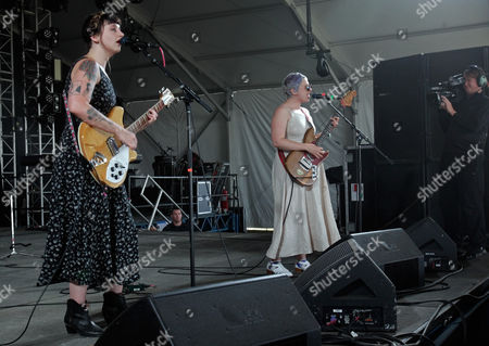 Katie Crutchfield, left, and her sister Allison Crutchfield of the band Waxahatchee perform at the Bonnaroo Music and Arts Festival, in Manchester Tenn