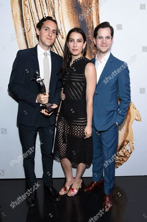 Swarovski Menswear Award winners, Alex Orley, Samantha Florence, and Matthew Orley, of Orley, pose at the CFDA Fashion Awards at the Hammerstein Ballroom, in New York