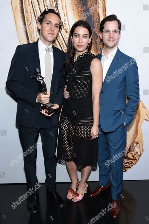 Stock Picture of Swarovski Menswear Award winners, Alex Orley, from left, Samantha Florence, and Matthew Orley, of Orley, pose at the CFDA Fashion Awards at the Hammerstein Ballroom, in New York