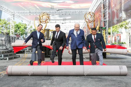 Television Academy Chairman and CEO Bruce Rosenblum, from left, host Jimmy Kimmel, producer Don Mischer and Guillermo Rodriguez roll out the red carpet at the 2016 Primetime Emmy Awards Press Preview Day at the Microsoft Theater, in Los Angeles