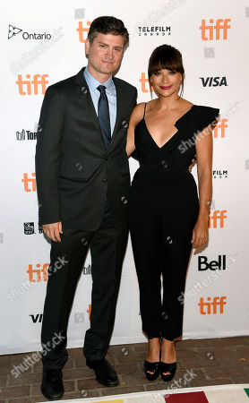 """Stock Picture of Mike Schur, left, and Rashida Jones, co-writers of the """"Black Mirror"""" episode """"Nosedive,"""" pose together at the premiere of the new season of the television series on day 5 of the Toronto International Film Festival at Ryerson Theatre, in Toronto"""