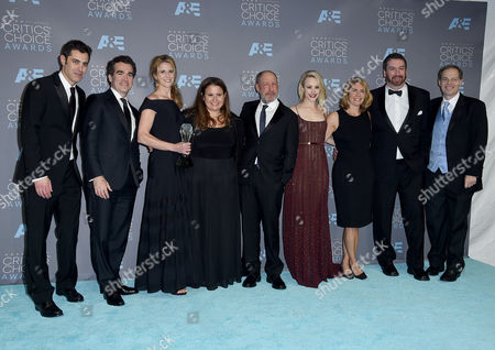 """The cast and crew of """"Spotlight,"""" Josh Singer, from left, Brian d'Arcy James, Blye Pagon Faust, Nicole Rocklin, Steve Golin, Rachel McAdams, Sacha Pfeiffer, and far right, Tom Ortenberg, pose in the press room with the award for best picture at the 21st annual Critics' Choice Awards at the Barker Hangar, in Santa Monica, Calif"""