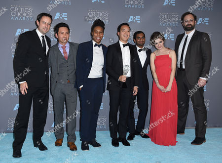 Stock Image of Igor Srubshchik, from left, Kelvin Yu, Lena Waithe, Alan Yang, Aziz Ansari, Noel Wells, and Eric Wareheim pose in the press room with the award for best comedy series for Master of None at the 21st annual Critics' Choice Awards at the Barker Hangar, in Santa Monica, Calif