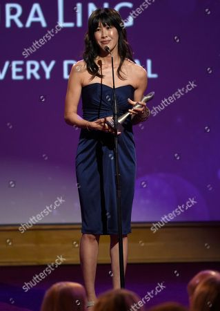 Stock Image of Laura Ling accepts the award for best online video host/correspondent for Discovery Digital Networks at the 41st annual Gracie Awards Gala at the Beverly Wilshire Hotel, in Beverly Hills, Calif