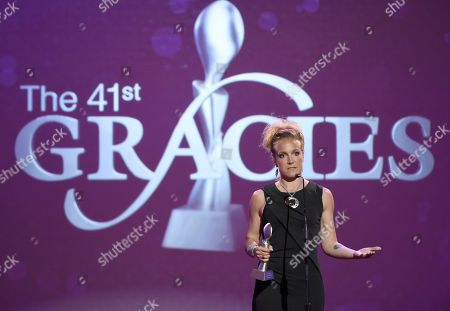 Arwa Damon accepts the award for outstanding reporter/correspondent for CNN International at the 41st annual Gracie Awards Gala at the Beverly Wilshire Hotel, in Beverly Hills, Calif