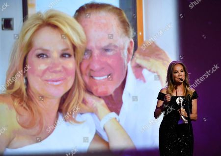 "Kathie Lee Gifford accepts the award for outstanding on-air talent for ""The Today Show"" at the 41st annual Gracie Awards Gala at the Beverly Wilshire Hotel, in Beverly Hills, Calif. Pictured on screen are Kathie Lee Gifford and her late husband Frank Gifford"