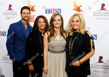 Stock Image of Karen Peck Gooch, right, Jeff Hawes, left, Susan Peck Jackson, second from the left, and Kari Gooch of the group Karen Peck and New River arrive at Lipscomb University for the Dove Awards, in Nashville, Tenn