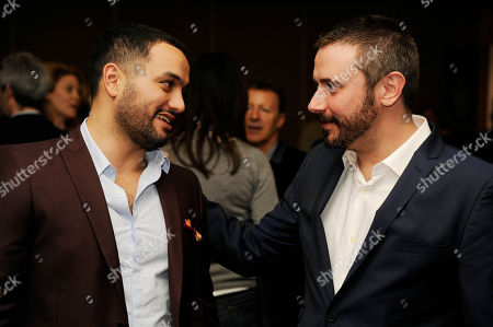 """Stock Photo of Jeremy Scahill, right, co-writer and cast member of the Oscar-nominated documentary film """"Dirty Wars,"""" mingles with Karim Amer, producer of the Oscar-nominated documentary film """"The Square,"""" at a reception featuring the Oscar nominees in the Documentary Feature and Documentary Short Subject categories, in Beverly Hills, Calif. The Oscars will be held on Sunday at the Dolby Theatre in Los Angeles"""