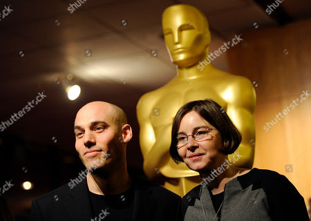 "Joshua Oppenheimer, left, director of the Oscar-nominated documentary film ""The Act of Killing,"" poses with the film's producer Signe Byrge Sorensen at a reception featuring the Oscar nominees in the Documentary Feature and Documentary Short Subject categories, in Beverly Hills, Calif. The Oscars will be held on Sunday at the Dolby Theatre in Los Angeles"