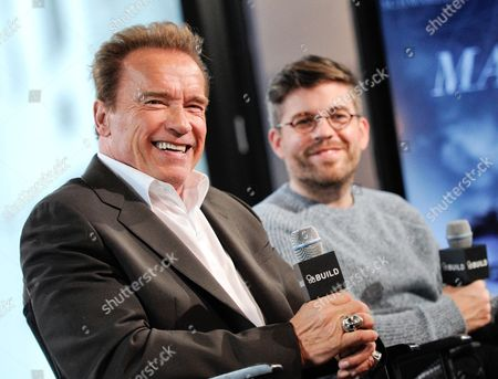 "Actor Arnold Schwarzenegger, left, and director Henry Hobson participate in AOL's BUILD Speaker Series to discuss their new film ""Maggie"", at the AOL Studios, in New York"