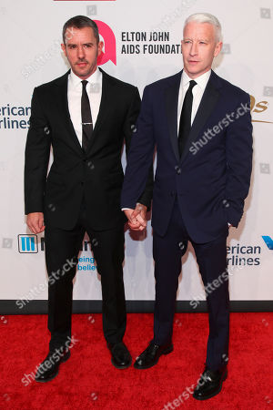 "Benjamin Maisani, left, and Anderson Cooper, attend the Elton John AIDS Foundation's 14th Annual ""An Enduring Vision"" Benefit at Cipriani Wall Street, in New York"