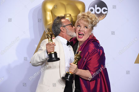 Colin Gibson, left, and Lisa Thompson pose with the award for best production design for Mad Max: Fury Road in the press room at the Oscars, at the Dolby Theatre in Los Angeles