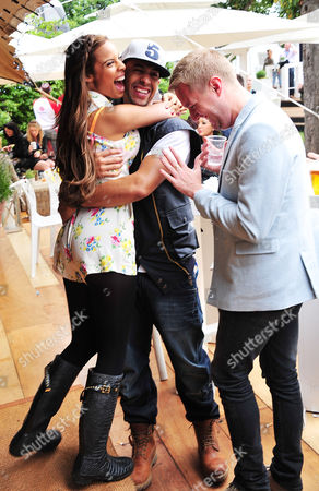 Rochelle Wiseman of the Saturdays and Marvin Humes of JLS with Dean Piper (R) attend the Barclaycard Unwind Lounge at Day 2 of the Barclaycard Wireless Festival, in London, United Kingdom