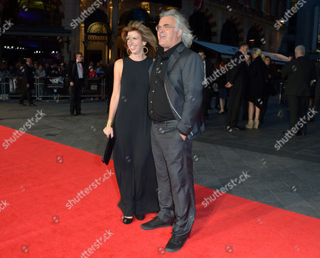English film director Paul Greengrass (right) and wife Joanna Greengrass attend the European Premiere of Captain Phillips during the 57th BFI London Film Festival in partnership with American Express at Odeon West End on in London