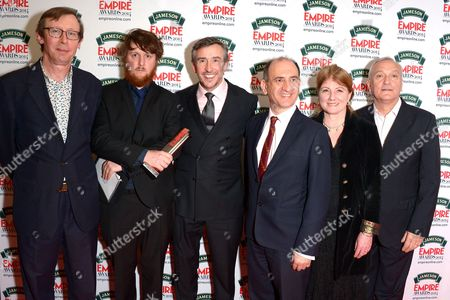 From left, Kevin Loader, guest, Steve Coogan, Armando Iannucci, Felicity Montagu and Simon Greenall, winners of the best comedy award for Alpha Papa pose in the press room during the Jameson Empire Awards 2014 at the Grosvenor Hotel, London