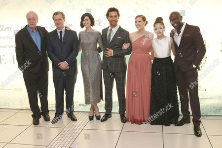 Actor Michael Caine, director Christopher Nolan, actors Anne Hathaway, Matthew McConaughey, Jessica Chastain, Mackensie Foy and David Gyasi pose for photographers upon arrival at the premiere of the film Interstellar, in central London