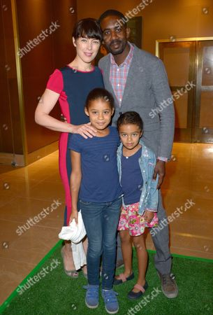 Olivia Williams, Rhashan Stone with their daughters Roxana May Stone and Esme Ruby Stone attend the UK Premiere of 'Justin and the Knights of Valour' at the Mayfair Hotel, in London