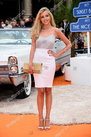 Alice Barlow poses for photographers upon arrival at the UK premiere of the film 'The Nice Guys ' at a central London cinema, London