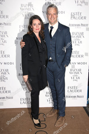 Olivia Colman and Ed Sinclair poses for photographers upon arrival at the Harper's Bazaar Women of the Year Awards in London