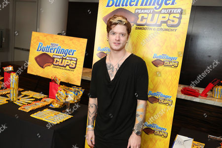 Musician Nash Overstreet samples Butterfinger Cups, as Butterfinger butts into awards season at Kari Feinstein's Oscars Style Lounge on in West Hollywood, Calif. Fans can see more of the Butterfinger Commentators at ButterfingerCups.com