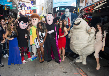 """Fifth Harmony members, from left, Ally Brooke Hernandez, Normani Kordei, Lauren Jauregui, Dinah Jane Hansen and Camila Cabello pose with """"Hotel Transylvania 2"""" costumed characters at the world premiere of their new video """"Hotel Transylvania 2"""" at the Hard Rock Cafe, in New York"""