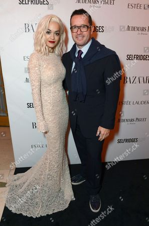 Rita Ora and Francois-Henry Bennahmias attend Harper's Bazaar Women of the Year Awards 2013 at Claridge's Hotel, in London